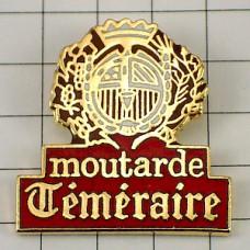 ピンバッジ・マスタード会社の紋章