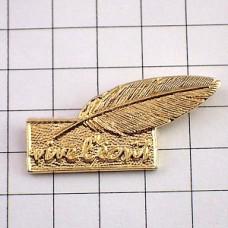 ピンズ・金色の羽根ペン文房具