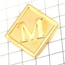 ピンバッジ・Mモノプリデパート金色