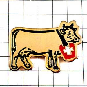 ピンバッジ・金色ゴールドのウシ牛スイス国旗模様のベル鐘