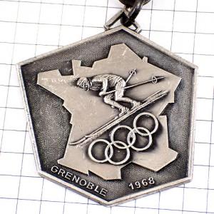 キーホルダー・スキー選手グルノーブル冬季オリンピック五輪アルプス鹿エーデルワイス鷲アンティーク中古品