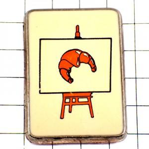 ピンバッジ・クロワッサンのデッサン絵画パン一個イーゼルとキャンバス画