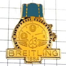 ピンバッジ・青のベルトのブライトリング腕時計