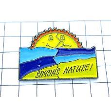 ピンズ・自然に!海と日の出の太陽