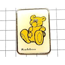 ピンバッジ・黄色い熊のぬいぐるみコダック写真